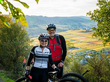 Mountainbiker couple in the woods of Wolf